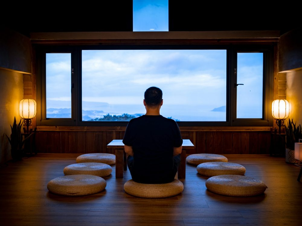 Lonely man relaxing while observing the landscape