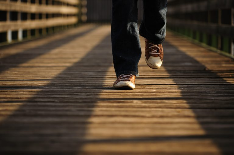 Walking on a lane of sunshine, on a jetty, on planks